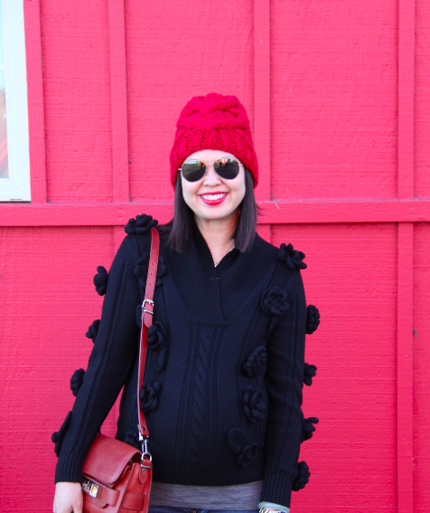 red knit beanie and navy chanel camellias sweater