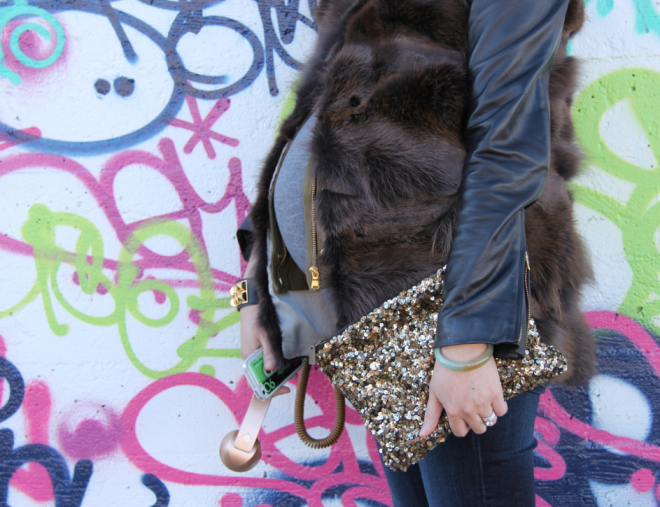 sequin clutch, gold pop handset phone and fur vest