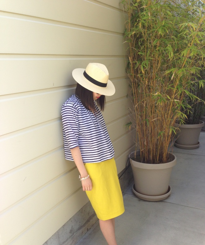 panama hat, stripe top and yellow skirt