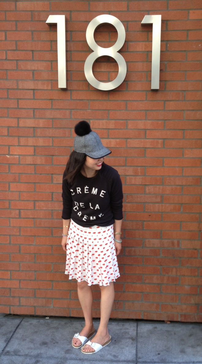 95306f1df7 Skirt: Prada (old and last seen here). Fur pom cap: Lola Hats. Shoes:  Birkenstock. Bracelets: Chanael K and Cartier. Watch: vintage Rolex.