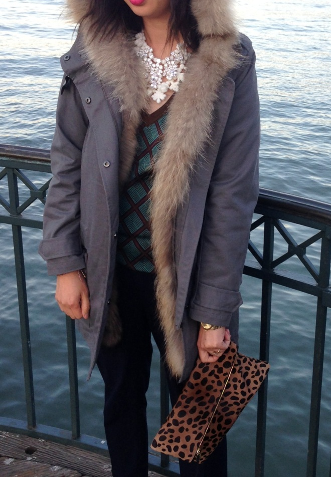 maje fur lined parka and clair vivier leopard foldover clutch bag