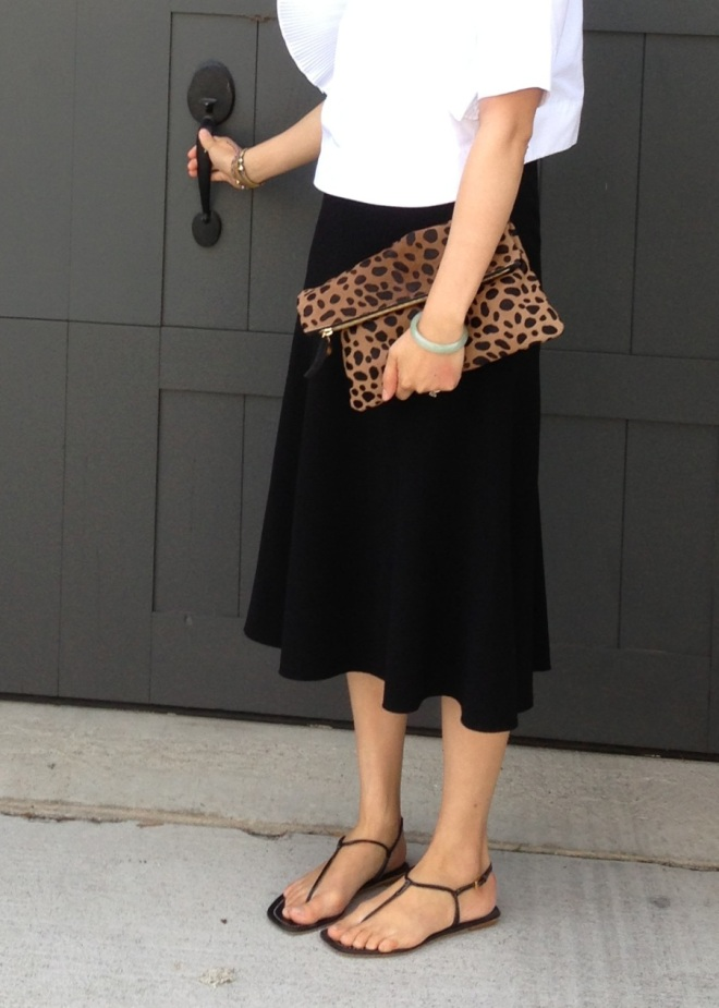 clare vivier fold over leopard clutch bag