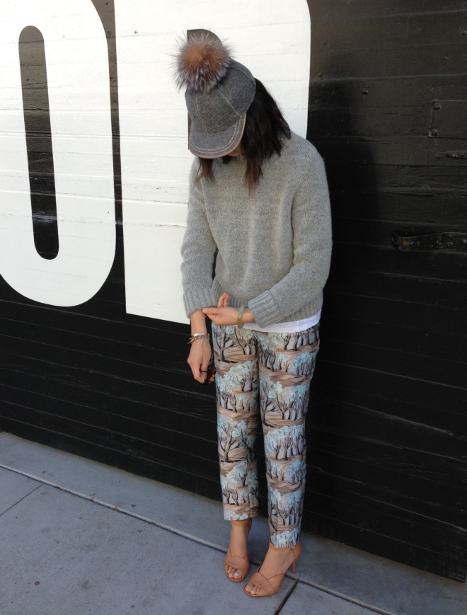fur pom, grey and printed pants