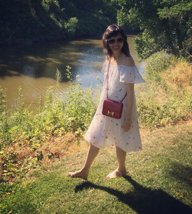 vika gazinskaya x & other stories dress with red hermes constance bag