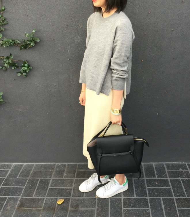 black Celine belt bag and Adidas stan smiths