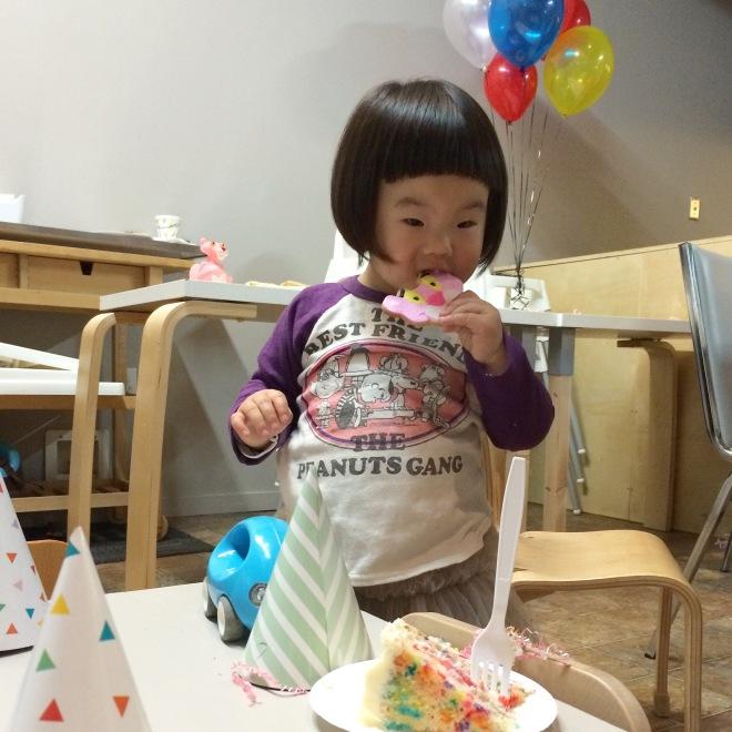 Marni enjoying her pink panther cookie