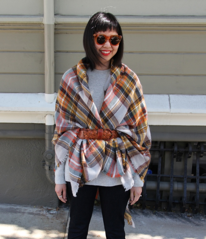 zara plaid blanket scarf worn as a poncho